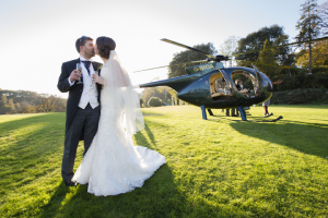arrive in style wedding couple helicopter Pentillie Castle cornwall