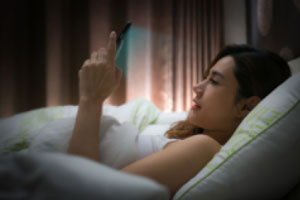Women reading with blue light preparing for a good nights sleep
