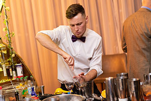 Man working bar at wedding to remember