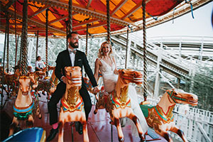 couple on carousel at wedding location