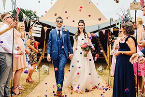 Couple having confetti thrown over them after getting married