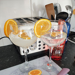 Gin served in Copa glasses