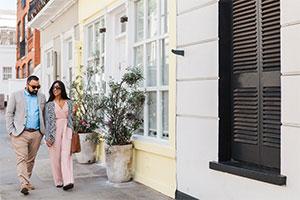 Radhika & You walking down colourful street wedding planning