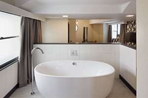 Roomzzzz aparthotels are ideal for a stag or hen party - bathroom with freestanding bath