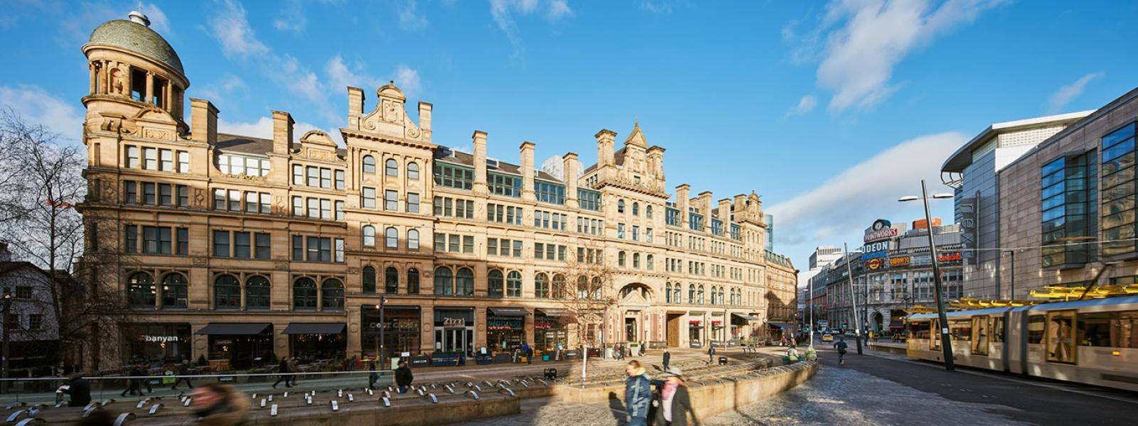 Roomzzzz aparthotels are ideal for a stag or hen party - exterior of Corn Exchange on busy street