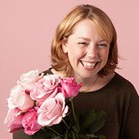 wedding flowers: Caroline Grimble – Bloom & Wild's Lead Florist – with a bouquet