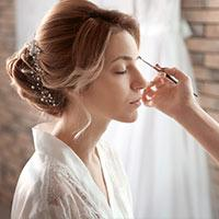 Bride having makeup done