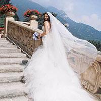 Bride walking up stairs in wedding dress