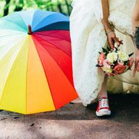 Colourful umbrella at outdoor wedding