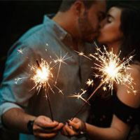 Couple with sparklers kissing