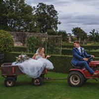 Couple on tractor outside of County Durham hotel