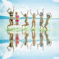 Girls jumping in ocean in Ibiza