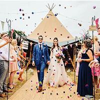 Couple in front of camper van at wedding fair