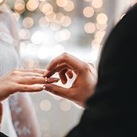 Man giving woman wedding ring