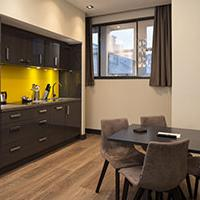 Roomzzzz aparthotels are ideal for a stag or hen party - lounge/kitchen area