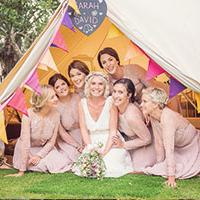 Girls sat in glamping tent at wedding