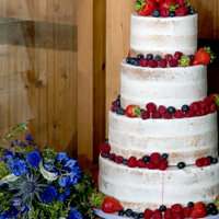 Stable Cottage 4 tier Vegan Wedding Cake with summer berries and flowers