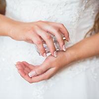 Bride spraying wedding fragrance