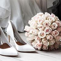 Wedding shoe and pink bouquet