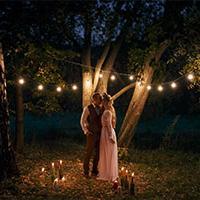 Couple stood together on wedding night