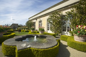 The Lost Orangery With Pruned Topiary Trickling Fountains