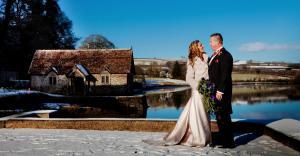 waterside wedding couple, Pentillie Castle, Cornwall