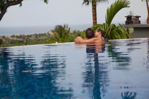 zen resort pool couple